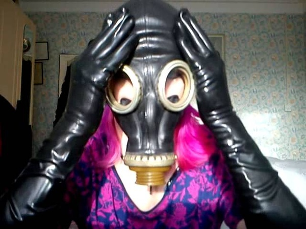 Gas Mask Girl Putting On Latex Gloves