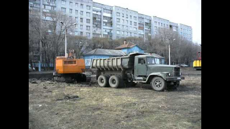 Old soviet excavator EO-5123 n dump truck KrAZ-256B1