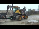 Volvo EWR150E excavator loading crushed stone on a trolley connected to the machine feb 2017