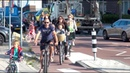 Watch as 100s of Kids Parents Bicycle to one Amsterdam School