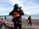 Rubber wetsuit scuba diver by the sea