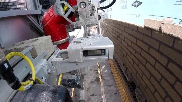 Masonry Construction Robot laying Bricks on a construction site coub