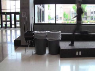 new fail.. kid tries to jump two trash cans and desk