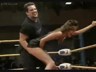 Man wrestling woman