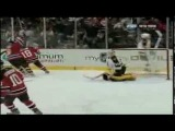 Unlucky Bounce: Tim Thomas tries to sweep puck away and misses