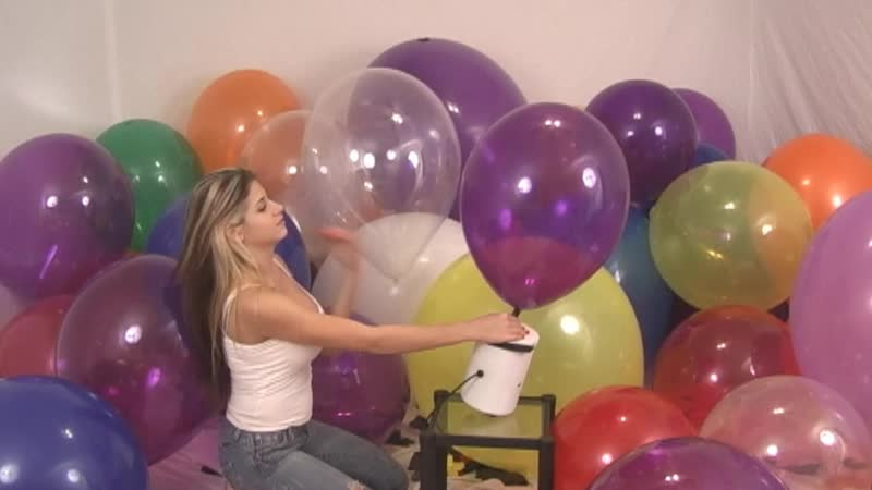 Tara inflating balloons on set