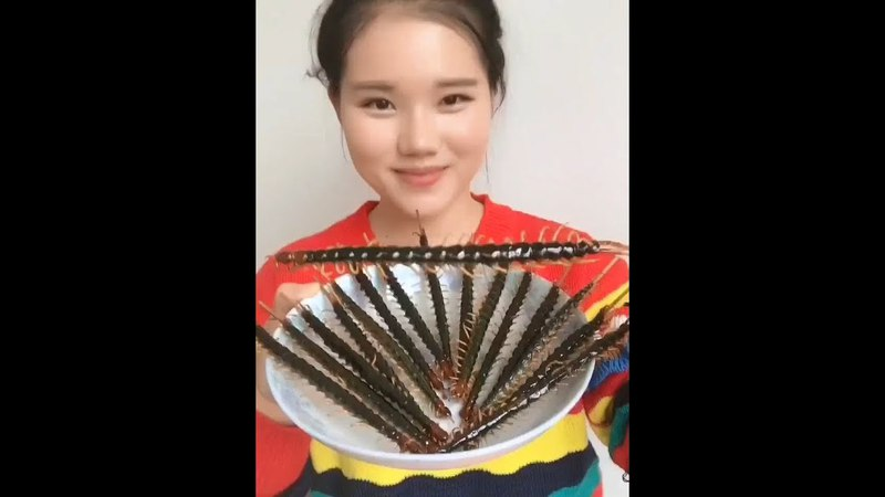 Chinese Girl Eating scorpions, centipedes , insects and Bugs