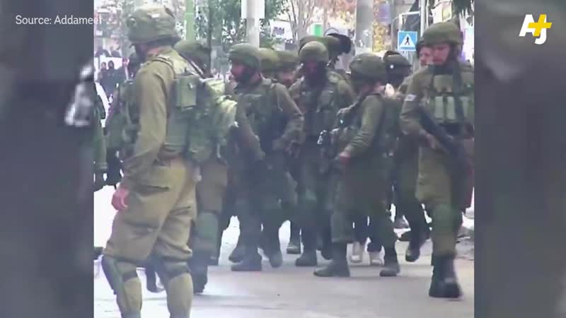 Israeli occupation forces blocked these Palestinian farmers from harvesting their olive crop in the