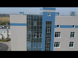 Nurse Waving from window of Kursk Oncology Center