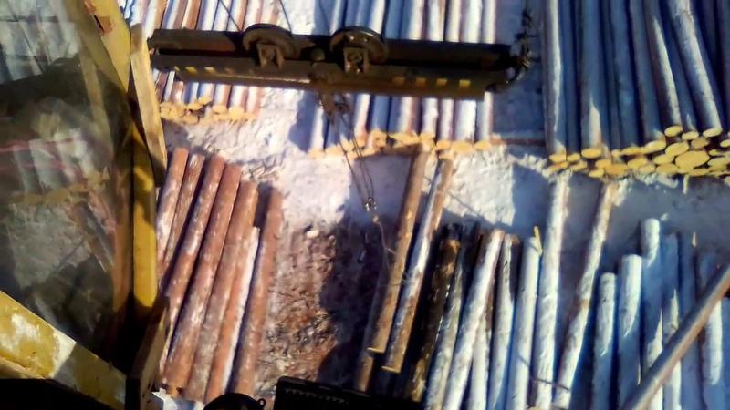 Лесопилка, штабеля леса, станки и рамы - видео с козлового крана - Сибирь Иркутская область