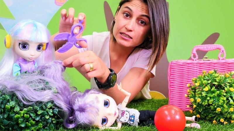 Çocuk oyunları. Ayşe piknik yapan kızların saçlarını topluyor