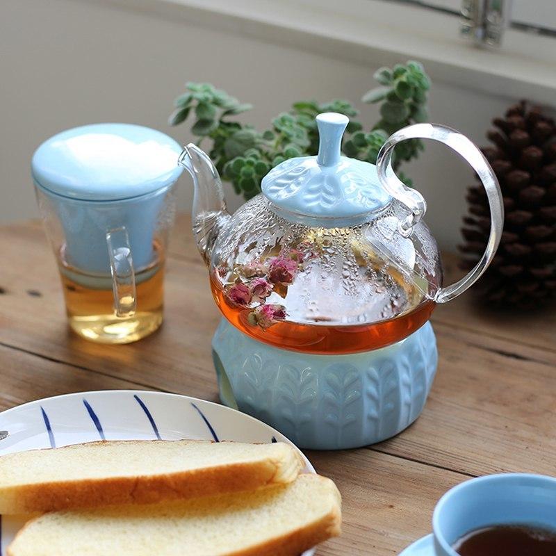 Стеклянный заварочный чайник который сохраняет тепло подогреваясь от свечи