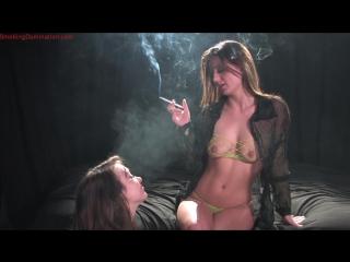 Mistress Denice K dominates female slave with her smoke