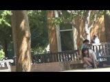 Girls sit on face in public prank