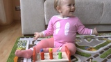 Alice has fun with learning toy for babies