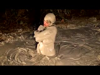 Babe-with-big-boobs-covers-every-inch-of-her-body-with-mud
