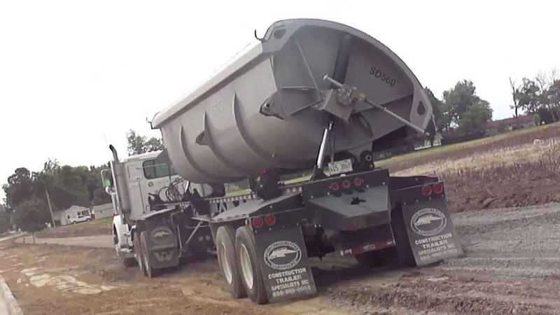 New Western Star Truck Tipping its Sidedump On the Fly with a Deere 750J dozer