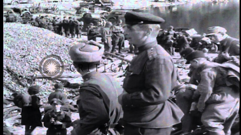 Russian soldiers supervise the unloading of German prisoners of war on East bank ...HD Stock Footage