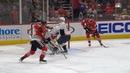 Dmitry Orlov bats puck in past his own goaltender