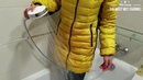 Yellow wet downjacket and NB sneakers