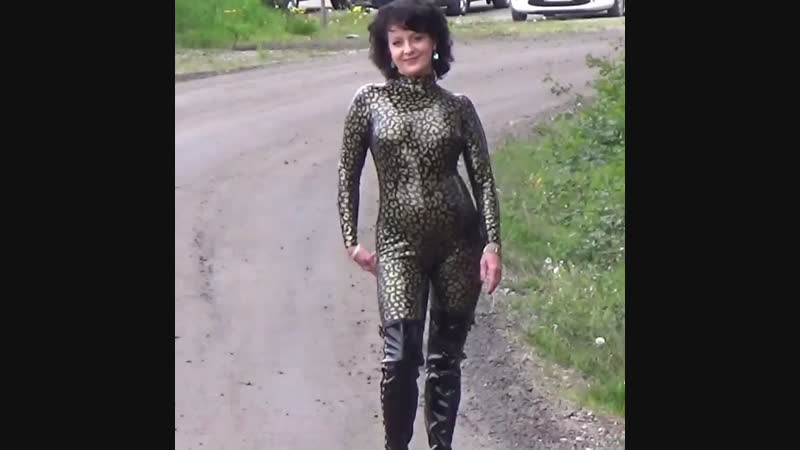 Latex Olga walking in various catsuits