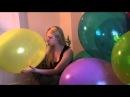 Sue make a blow to pop yellow balloon