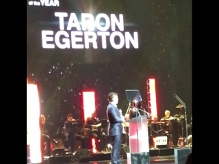 Taron Egerton receiving Action Star of the year at CinemaCon in Vegas