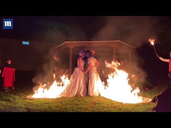 Brides set their dresses on fire after saying vows