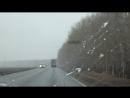 Весенняя дорога через снегопад