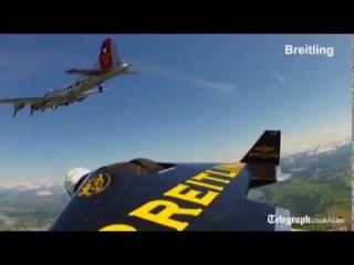 'Jetman' adventurer Yves Rossy flies with B17 bomber aircraft