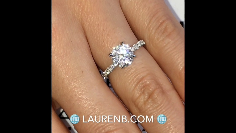 7.5mm Round Moissanite in classic four prong pave design