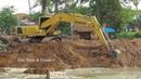 River Bank Reinforcement Construction by Long Reach Excavator Cat PC 200