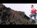 Lava run man runs over glowing lava flow on volcano Etna