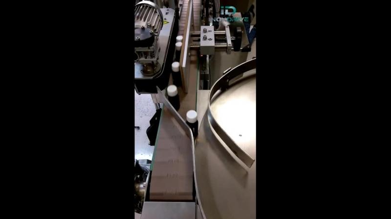 Переход продукции с конвейера на накопительный стол