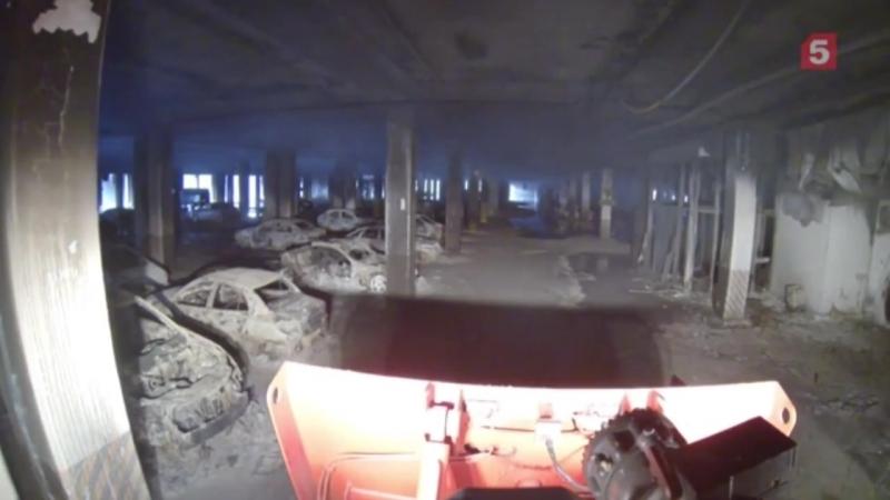 Робот Ель-10 тушит пожара на рынке Синдика