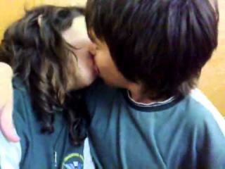 Preteen Boy Kissing a Preteen Girl