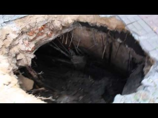 Crater in Central Lugansk - Ukraine Military Shelling