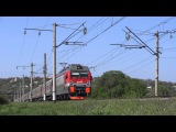 Electric locomotive EP1M-755 with passenger train in Bolshoy Log village