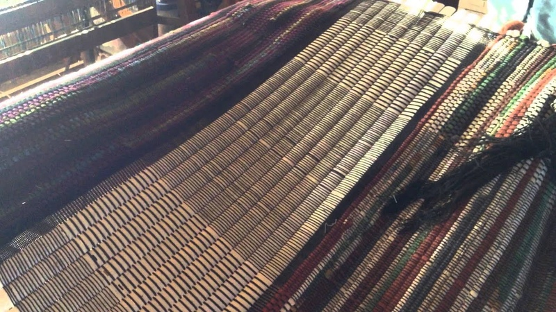 Cutting finished rugs off a 1936 Union Rug Loom