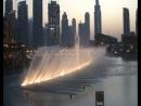 ОАЭ Дубай Музыкальный фонтан в Дубай Молл с видом на самую высокую башню в мире 828 м Бурдж Халифа