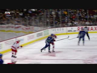 Sven Baertschi finishes tic-tac-toe from Elias Pettersson