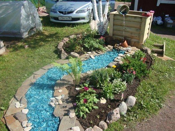 Клумбы в саду из камня своими руками