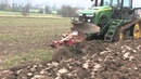 Front rear ploughing on a John Deere track tractor with Laforge front hitch and electronic control