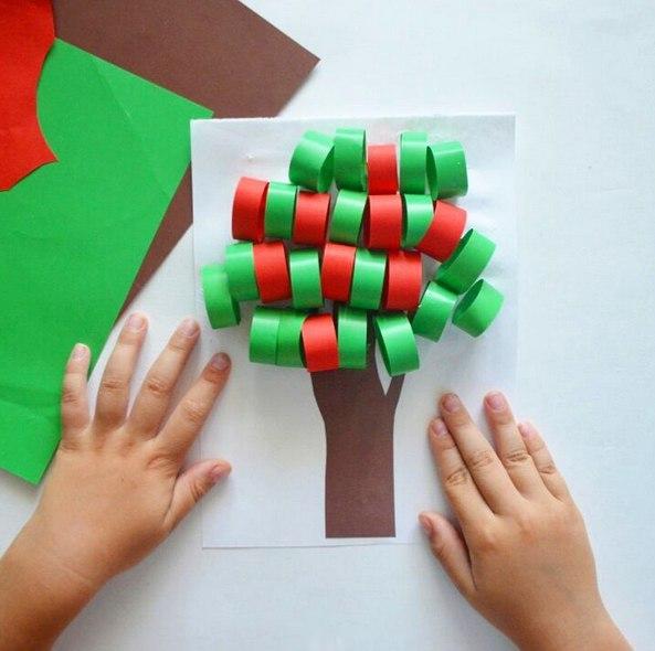ПОДЕЛКИ ИЗ БУМАГИ АППЛИКАЦИЯ. Объемная аппликация яблоня Для этой поделки из бумаги вам понадобятся: - цветная бумага: зеленого, красного, коричневого цветов; - ножницы; - клей; - белый