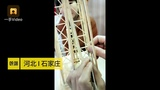 Check out the miniature of Eiffel Tower made from bamboo sticks and disposable chopsticks!