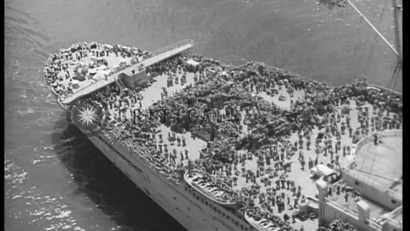 Pilot in cockpit of blimp Queen Mary shows United States troops on main deck of Stock Footage