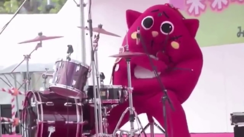 When a Costumed Person Destroys The Drums At Children's Music Concert - Nyango Star -