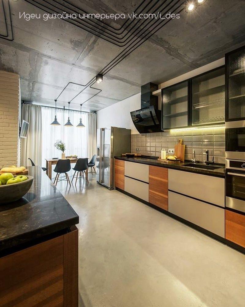 Интерьер кухни с гостиной в стиле лофт.