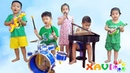 Xavi Pretend play Start a band with Music Toys