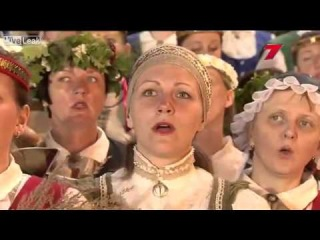15,000 people sing at a Latvian song and dance festival.